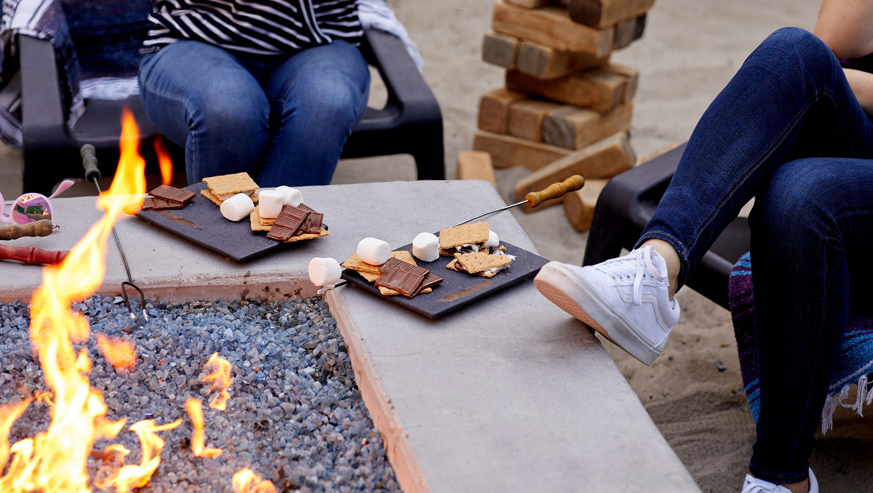 Kimpton Shorebreak guests roasting marshmallow