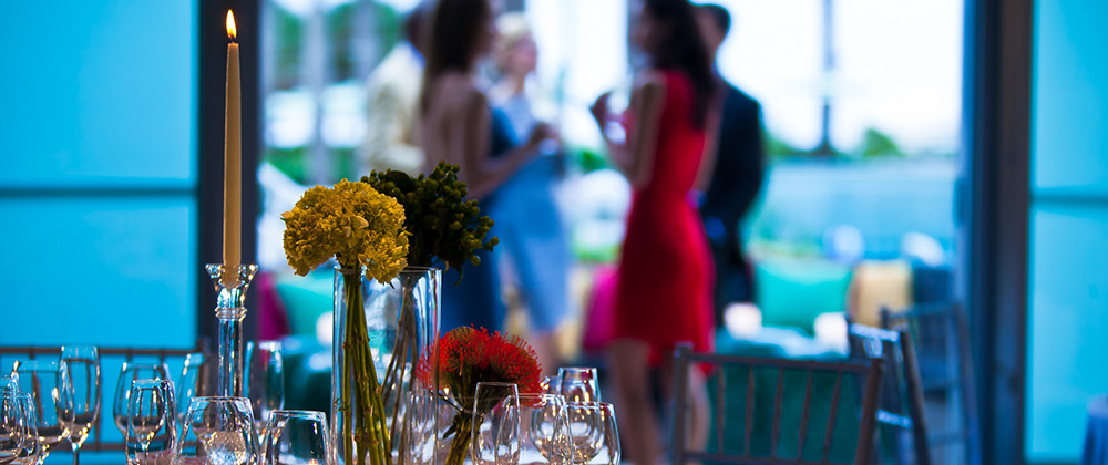 Kimpton shorebreak Hotel event table set with flowers and candles